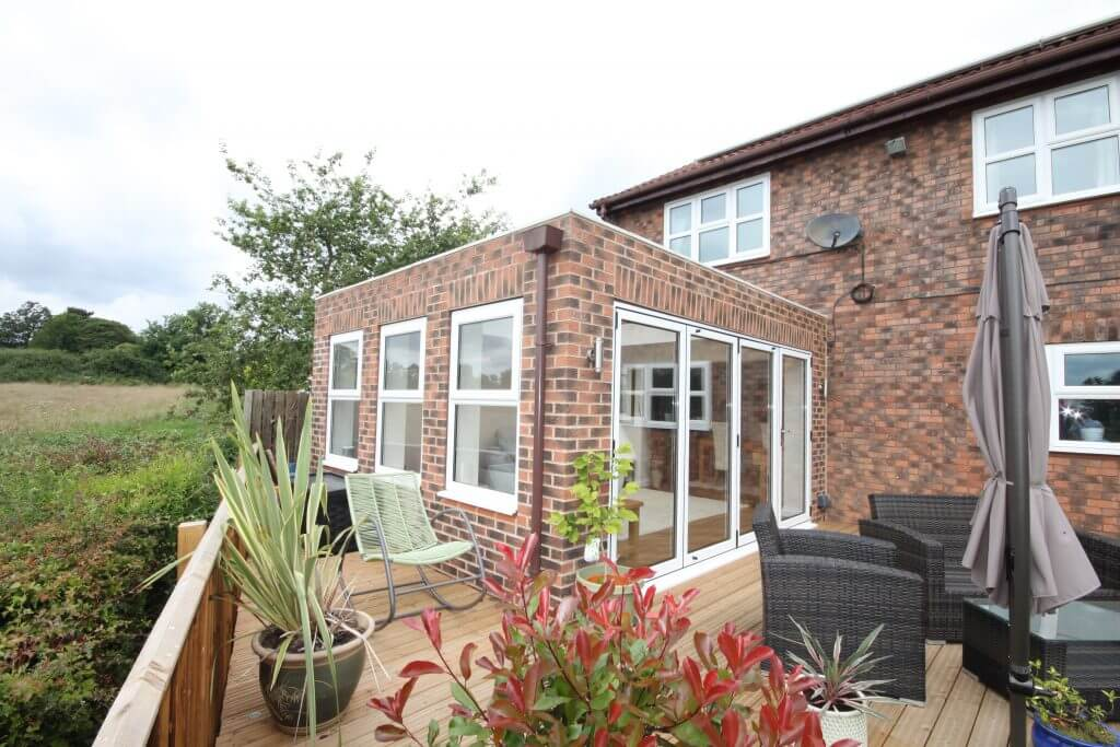 Contemporary orangery extension built by Chatsworth Windows